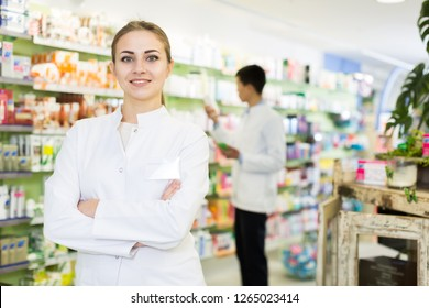 Portrait of woman pharmacist who is standing on her work place in apothecary.