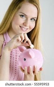portrait of woman with a piggy bank