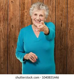 Portrait Of Woman Pointing Her Finger, Indoor