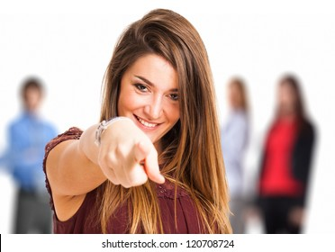 Portrait of a woman pointing her finger to you