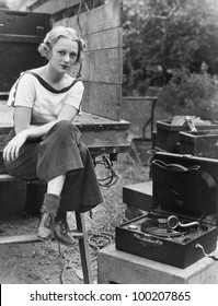 Portrait of woman with record player