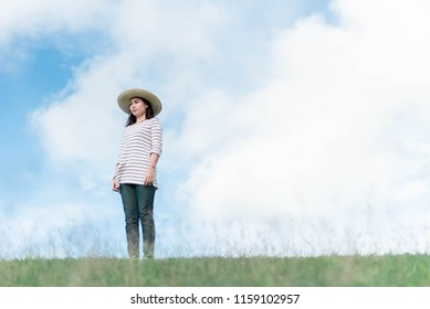 Portrait of a woman relaxing in the mountains with a bright sky in the spring.