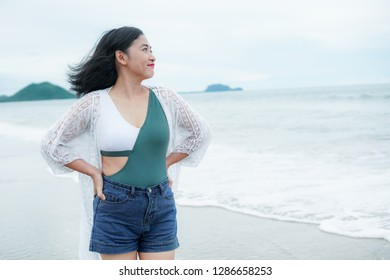 portrait of a woman relaxing on the beach