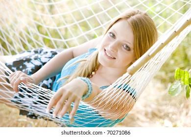portrait of woman resting in hammock