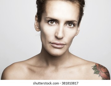 Portrait of a woman with a rose tattoo