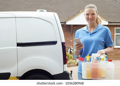 Portrait Of Woman Running Mobile Cleaning Business Checking Text Messages