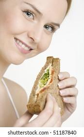portrait of woman with sandwich