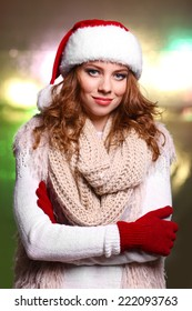 Portrait of woman in scarf and gloves on bright background
