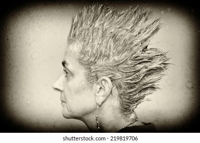 Portrait of a woman with shampooed spiky hair