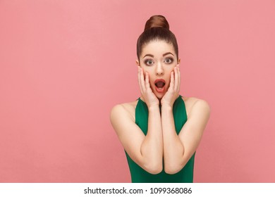 Portrait of woman with shocked face. Expression emotion and feelings concept. Studio shot, isolated on pink background