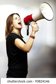 portrait of a woman shouting using a megaphone indoor