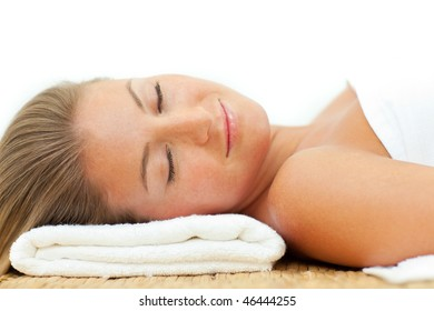 Portrait of woman sleeping after a spa treatment against a white background