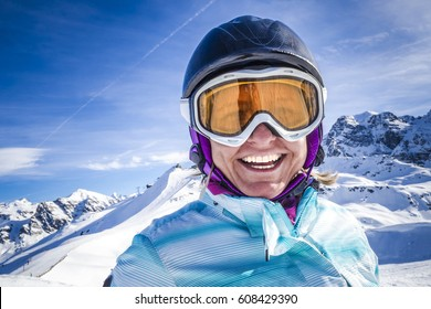 Portrait of woman smiling at the ski resort