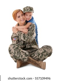 Portrait of woman soldier and her son on white background