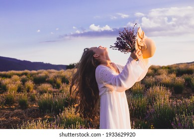Portrait of woman is standing among the plantations of lavender