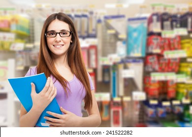 Portrait of a woman in a stationery store