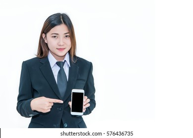 Portrait of a woman in suit with smart phone in hand.