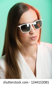 Portrait of woman in sunglasses with makeup
