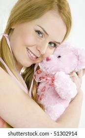 portrait of woman with teddy bear