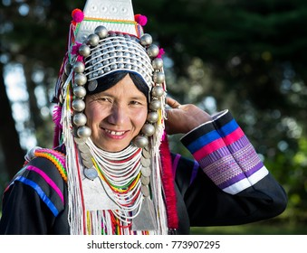 Portrait of woman in traditional clothes and silver jewelery at Chiangmai, Akha in hill tribe dress at north of Thailand enjoying, Lifestyle of hill tribe woman in the north of thailand.