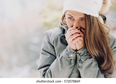 Portrait woman traveler with backpack warmly dressed for walk in mountains