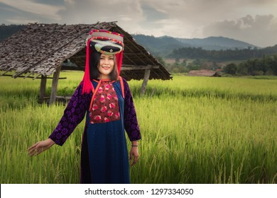 Portrait of woman tribal Lisu in traditional dress and jewelry costume in rice fields., Lifestyle of hill tribe girl in the north of Thailand.,Cultural outdoor portrait.