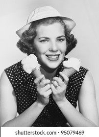 Portrait of woman with two ice cream cones