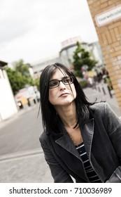 Portrait of a woman in urban surroundings.