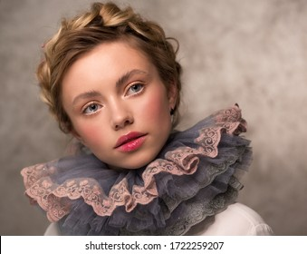 Portrait of a woman in a vintage medieval collar. Countess or princess. Lush ruff in the neck circle.