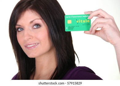 Portrait of a woman with a vital card