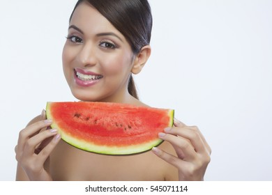 Portrait of a woman with a watermelon