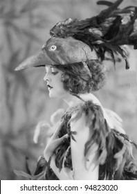 Portrait of woman wearing bird costume