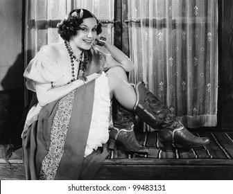 Portrait of woman wearing cowboy boots