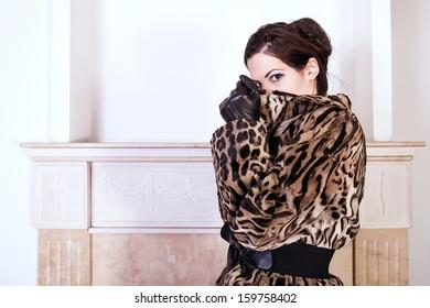 portrait of woman wearing fur coat