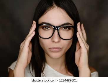 Portrait of woman wearing glasses. Selective focus.