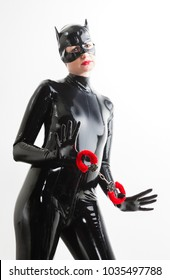 portrait of woman wearing latex clothes with handcuffs