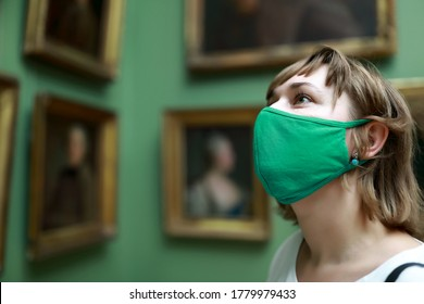 Portrait of woman wearing protection mask in picture gallery