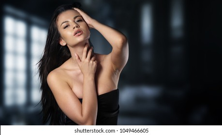 Portrait of a woman wearing a sexy black dress