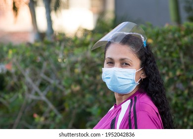 Portrait of a woman wears  respiratory mask and protective shield mask with unfocused background  during the coronavirus pandemic in Caracas, Venezuela in Latin America. Covid-19 coronavirus epidemic