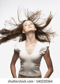 Portrait of woman whipping hair around