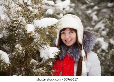 Portrait of  woman in wintry pine  forest