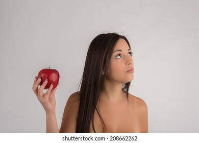 Portrait woman wondering with a red apple  ,looking up