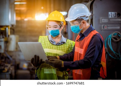 Portrait woman worker and engineer under inspection and checking production process on factory station by wearing safety mask to protect for pollution and virus in factory.