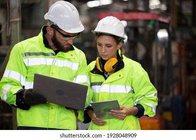 Portrait woman worker and engineer under inspection and checking production process on factory station