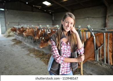 Portrait of woman working in barn