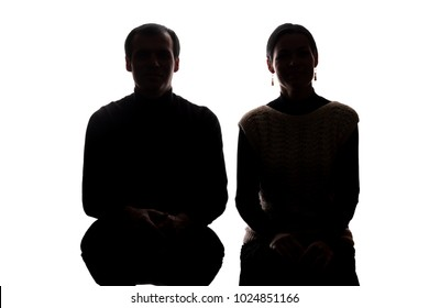 Portrait women and men across from, brother and sister squatted down - horizontal silhouette