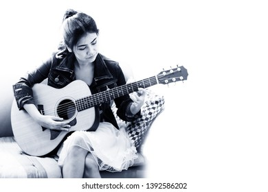 Portrait of women playing guitar white and black tone. Copy space.