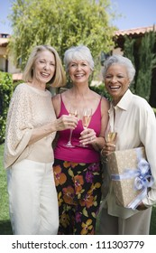 Portrait women standing together with glass of champagne