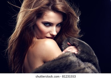 Portrait of wonderful woman in fur.