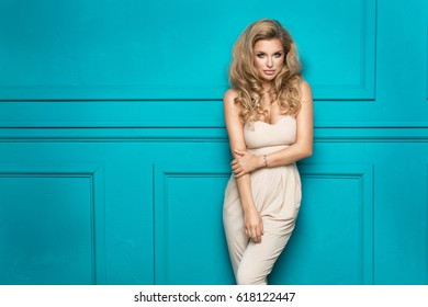 Portrait of wonderful young blonde woman with long hair looking at camera.